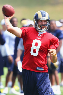 EARTH CITY, MO - JULY 31:  Sam Bradford #8 of the St. Louis Rams passes during training camp at the Russell Training Center on July 31, 2011 in Earth City, Missouri.  (Photo by Dilip Vishwanat/Getty Images)