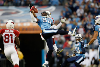 NASHVILLE, TN - NOVEMBER 29:  Steve Breaston #15 of the Arizona Cardinals breaks up a pass with Keith Bulluck #53 of the Tennessee Titans during their game at LP Field on November 29, 2009 in Nashville, Tennessee.  (Photo by Streeter Lecka/Getty Images)