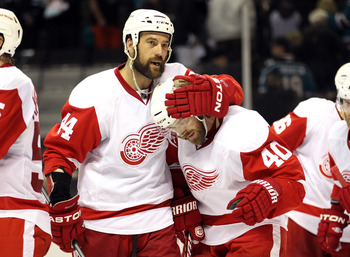 SAN JOSE, CA - MAY 08:  Todd Bertuzzi #44 and Henrik Zetterberg #40 of the Detroit Red Wings celebrate after they beat the San Jose Sharks in Game Five of the Western Conference Semifinals during the 2011 NHL Stanley Cup Playoffs at HP Pavilion on May 8,