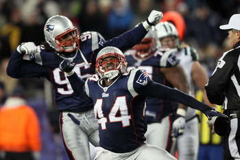 FOXBORO, MA - DECEMBER 06:  (L-R) Jermaine Cunningham #96 and Jarrad Page #44 of the New England Patriots celebrate a defensive stop in the second quarter against the New York Jets at Gillette Stadium on December 6, 2010 in Foxboro, Massachusetts.  (Photo