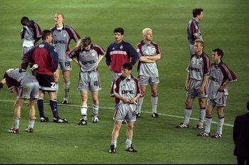 26 May 1999:  Bayern Munich players devastated after defeat in the UEFA Champions League Final against Manchester United at the Nou Camp in Barcelona, Spain. United scored twice in injury time to win 2-1. \ Mandatory Credit: Gary M Prior/Allsport