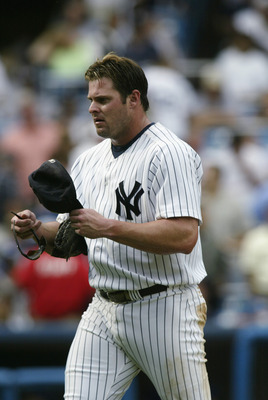 BRONX, NY - AUGUST 26:  Jason Giambi #25 of the New York Yankees grabs his gear and heads onto the field during the game against the Texas Rangers at Yankee Stadium in the Bronx, New York, on August 26, 2002. The Yankees defeated the Rangers 10-3. (Photo