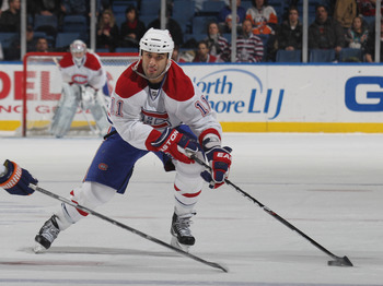 UNIONDALE, NY - DECEMBER 26:  Scott Gomez #11 of the Montreal Canadiens skates against the New York Islanders at the Nassau Coliseum on December 26, 2010 in Uniondale, New York. The Islanders defeated the Canadiens 4-1.  (Photo by Bruce Bennett/Getty Imag