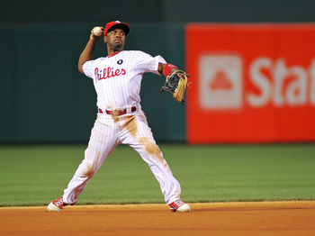 PHILADELPHIA - JUNE 15:  Jimmy Rollins #11 of the Philadelphia Phillies throws the ball toward first base against the Florida Marlins during game two of a day night double header at Citizens Bank Park on June 15, 2011 in Philadelphia, Pennsylvania.  (Phot