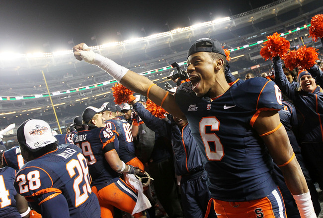 NEW YORK, NY - DECEMBER 30:  Da'Mon Merkerson #6 of the Syracuse Orange celebrates victory with team mates after defeating the Kansas State Wildcats during the New Era Pinstripe Bowl at Yankee Stadium on December 30, 2010 in New York, New York.  (Photo by