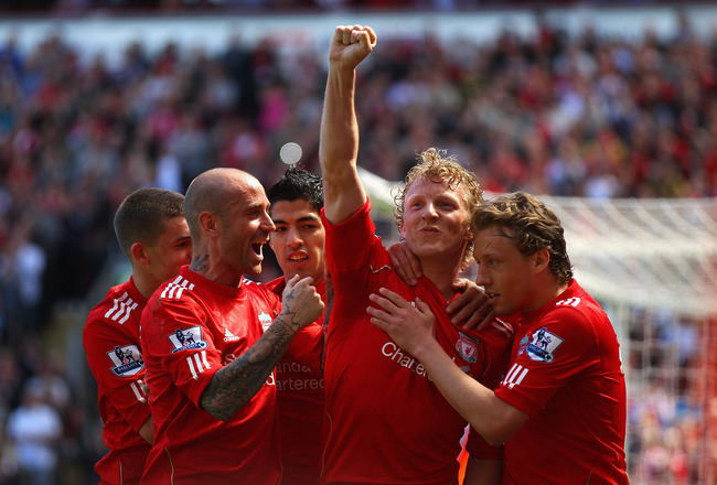 LIVERPOOL, ENGLAND - MAY 01:  Dirk Kuyt of Liverpool celebrates with team mates after scoring the second goal from the penalty spot during the Barclays Premier League match between Liverpool  and Newcastle United at Anfield on May 1, 2011 in Liverpool, En