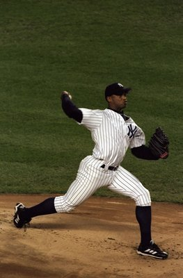 18 Oct 1998:  Pitcher Orlando Hernandez #26 of the New York Yankees in action during the 1998 World Series Game 2 against the San Diego Padres at the Yankee Stadium in the Bronx, New York. The Yankees defeated the Padres 9-3.
