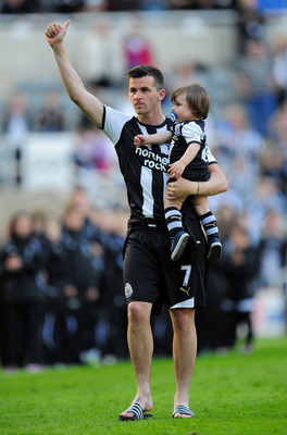 NEWCASTLE UPON TYNE, ENGLAND - MAY 22:  Newcastle player Joey Barton waves to the crowd after the Barclays Premier League game between Newcastle United and West Bromwich Albion at St James' Park on May 22, 2011 in Newcastle upon Tyne, England.  (Photo by