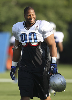 ALLEN PARK, MI - AUGUST 01: Ndamukong Suh #90 of the Detroit Lions get ready for the start of the days practice session at the Lions training facility on August 1, 2011 in Allen Park, Michigan.  (Photo by Leon Halip/Getty Images)
