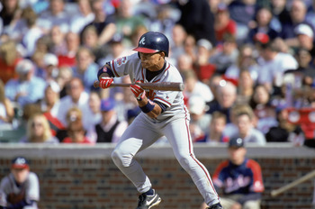 CHICAGO - MAY 29:  Shortstop Rafael Furcal #1 of the Atlanta Braves bunts during the MLB game against the Chicago Cubs at Wrigley Field on May 29, 2000 in Chicago, Illinois.  The Braves defeated the Cubs 1-0.  (Photo by Jonathan Daniel/Getty Images)