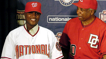 Esmailyn-gonzalez-seen-here-with-then-coach-frank-robinson-having-signed-with-the-washington-nationals_display_image