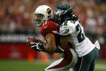GLENDALE, AZ - JANUARY 18:  Wide receiver Larry Fitzgerald #11 of the Arizona Cardinals attempts to break a tackle by cornerback Asante Samuel #22 of the Philadelphia Eagles during the NFC championship game on January 18, 2009 at University of Phoenix Sta