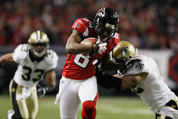 ATLANTA, GA - DECEMBER 27:  Roddy White #84 of the Atlanta Falcons fights off the tackle of Darren Sharper #42 of the New Orleans Saints during their game at the Georgia Dome on December 27, 2010 in Atlanta, Georgia.  (Photo by Scott Halleran/Getty Images