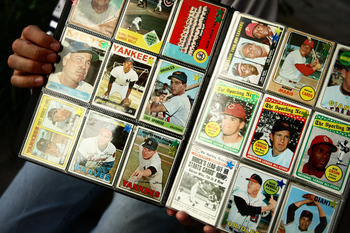 NEW YORK - SEPTEMBER 21: A man sells vintage baseball cards prior to the start of the last game at Yankee Stadium between the Baltimore Orioles and the New York Yankees on September 21, 2008 at Yankee Stadium in the Bronx borough of New York City. Yankee