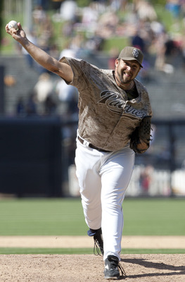 SAN DIEGO, CA - JULY 31: Pitcher Heath Bell #21 of the San Diego Padres throws the ball against the Colorado Rockies at Petco Park on July 31, 2011 in San Diego, California. (Photo by Kent C. Horner/Getty Images)