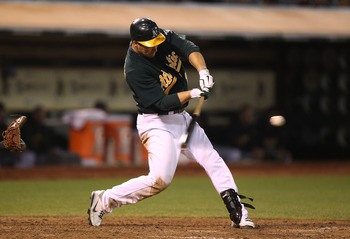 OAKLAND, CA - JULY 29:  Josh Willingham #16 of the Oakland Athletics hits a three-run home run against the Minnesota Twins in the eighth inning at O.co Coliseum on July 29, 2011 in Oakland, California.  (Photo by Jed Jacobsohn/Getty Images)