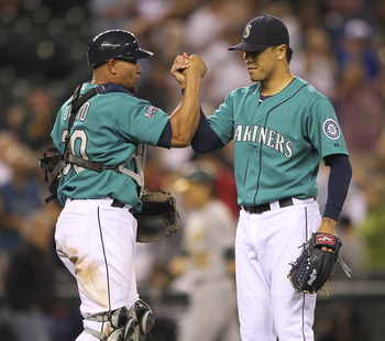 SEATTLE - AUGUST 01:  Closing pitcher Brandon League #43 of the Seattle Mariners celebrates with catcher Miguel Olivo #30 after defeating the Oakland Athletics 8-4 at Safeco Field on August 1, 2011 in Seattle, Washington. (Photo by Otto Greule Jr/Getty Im
