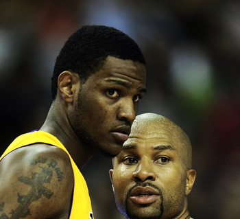 BARCELONA, SPAIN - OCTOBER 07:  Devin Ebanks #3 (L) of the Los Angeles Lakers and his teammate Derek Fisher #2 chat during the NBA Europe Live match between Los Angeles Lakers and Regal FC Barcelona at the at Palau Blaugrana on October 7, 2010 in Barcelon