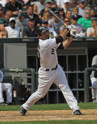 CHICAGO, IL - JULY 27:  Carlos Quentin #20 of the Chicago White Sox takes a swing against the Detroit Tigers at U.S. Cellular Field on July 27, 2011 in Chicago, Illinois. The White Sox defeated the Tigers 2-1.  (Photo by Jonathan Daniel/Getty Images)