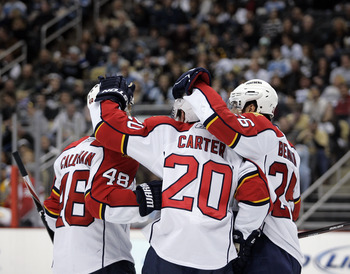 PITTSBURGH, PA - MARCH 27: Ryan Carter #20 of the Florida Panthers celebrates his second period goal with teammates against the Pittsburgh Penguins at Consol Energy Center on March 27, 2011 in Pittsburgh, Pennsylvania. (Photo by Justin K. Aller/Getty Imag