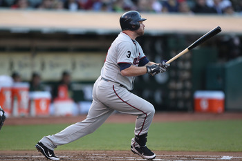 OAKLAND, CA - JULY 29:  Jason Kubel #16 of the Minnesota Twins hits a two run double against the Oakland Athletics at O.co Coliseum on July 29, 2011 in Oakland, California.  (Photo by Jed Jacobsohn/Getty Images)