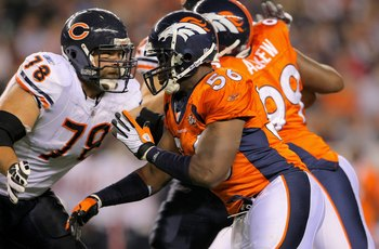 DENVER - AUGUST 30:  Offensive tackle Kevin Shaffer #78 of the Chicago Bears blocks against the rush of linebacker Robert Ayers #56 of the Denver Broncos during preseason NFL action at INVESCO Field at Mile High on August 30, 2009 in Denver, Colorado. The