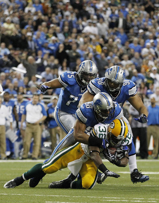 DETROIT - DECEMBER 12: Julian Peterson #98 and Ndamukong Suh #90 of the Detroit Lions tackles Brandon Jackson #32 of the Green Bay Packers during the game at Ford Field on December 12, 2010 in Detroit, Michigan. The Lions defeated the Packers 7-3.  (Photo