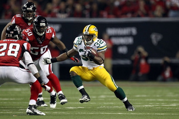 ATLANTA, GA - JANUARY 15:  Brandon Jackson #32 of the Green Bay Packers runs the ball against the Atlanta Falcons during their 2011 NFC divisional playoff game at Georgia Dome on January 15, 2011 in Atlanta, Georgia. The Packers won 48-21. (Photo by Stree