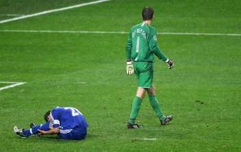 MOSCOW - MAY 21:  Edwin Van der Sar of Manchester United walks past John Terry of Chelsea, who has just missed a penalty attempt during the UEFA Champions League Final match between Manchester United and Chelsea at the Luzhniki Stadium on May 21, 2008 in