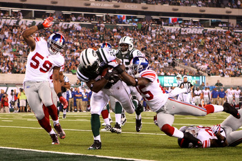 EAST RUTHERFORD, NJ - AUGUST 16:  LaDanian Tomlinson #21 of the New York Jets falls into the endzone for a touchdown that was eventually called back during their game against the New York Giants at New Meadowlands Stadium on August 16, 2010 in East Ruther