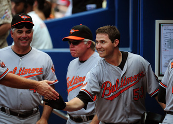 ATLANTA - JULY 3: Zach Britton #53 of the Baltimore Orioles is congratulated by teammates after hitting a 3rd inning home run against the Atlanta Braves at Turner Field on July 3, 2011 in Atlanta, Georgia. (Photo by Scott Cunningham/Getty Images)