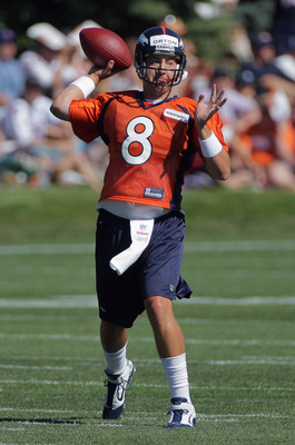 ENGLEWOOD, CO - JULY 28:  Quarterback Kyle Orton #8 of the Denver Broncos makes a pass during training camp at the Paul D. Bowlen Memorial Broncos Centre at Dove Valley on July 28, 2011 in Englewood, Colorado.  (Photo by Doug Pensinger/Getty Images)