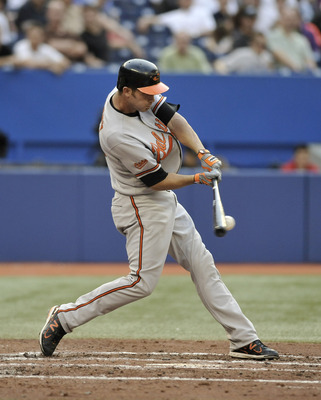 TORONTO, CANADA - JULY 27:  J.J. Hardy #2 of the Baltimore Orioles bats during MLB game action against the Toronto Blue Jays July 27, 2011 at Rogers Centre in Toronto, Ontario, Canada. (Photo by Brad White/Getty Images)