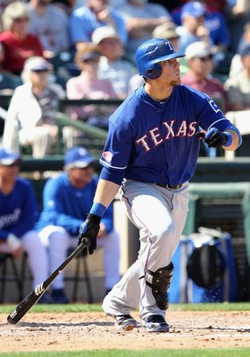 SURPRISE, AZ - MARCH 05:  Chris Davis #19 of the Texas Rangers bats against the Kansas City Royals during the MLB spring training game at Surprise Stadium on March 5, 2010 in Surprise, Arizona. The Royals defeated the Rangers 4-2.  (Photo by Christian Pet