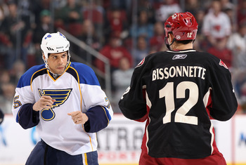 GLENDALE, AZ - MARCH 22:  Ryan Reaves #75 of the St. Louis Blues squares off with Paul Bissonnette #12 of the Phoenix Coyotes during a first period fight in the NHL game at Jobing.com Arena on March 22, 2011 in Glendale, Arizona.  (Photo by Christian Pete