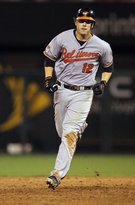 KANSAS CITY, MO - AUGUST 02:  Mark Reynolds #12 of the Baltimore Orioles rounds the bases after hitting a three-run home run during the 9th inning of the game against the Kansas City Royals on August 2, 2011 at Kauffman Stadium in Kansas City, Missouri.