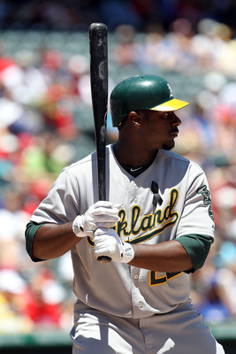 ARLINGTON, TX - JULY 10:  Chris Carter #22 of the Oakland Athletics at Rangers Ballpark in Arlington on July 10, 2011 in Arlington, Texas.  (Photo by Ronald Martinez/Getty Images)