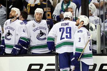 BOSTON, MA - JUNE 06:  Aaron Rome #29 of the Vancouver Canucks gets ejected due to misconduct in the first period to Nathan Horton #18 of the Boston Bruins during Game Three of the 2011 NHL Stanley Cup Final at TD Garden on June 6, 2011 in Boston, Massach
