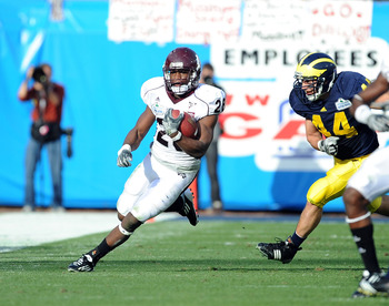 JACKSONVILLE, FL - JANUARY 01:  Running back Vick Ballard #28 of the Mississippi State Bulldogs rushes against the Michigan Wolverines during the Gator Bowl at EverBank Field on January 1, 2011 in Jacksonville, Florida  (Photo by Rick Dole/Getty Images)