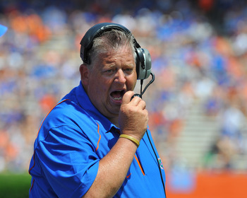 GAINESVILLE, FL - APRIL 9:  Offensive coordinator Charlie Weis of the Florida Gators directs play during the Orange and Blue spring football game April 9, 2011 at Ben Hill Griffin Stadium in Gainesville, Florida.  (Photo by Al Messerschmidt/Getty Images)