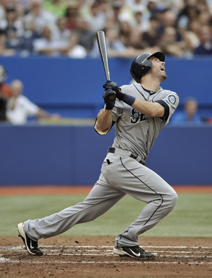 TORONTO, CANADA - JULY 20:  Dustin Ackley #13 of the Seattle Mariners bats during MLB game action against the Toronto Blue Jays July 20, 2011 at Rogers Centre in Toronto, Ontario, Canada. (Photo by Brad White/Getty Images)