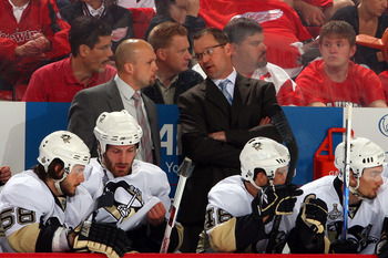 DETROIT - MAY 31:  Head coach of the Pittsburgh Penguins Dan Bylsma talks with Mike Yeo as their team plays against the Detroit Red Wings during Game Two of the 2009 Stanley Cup Finals at Joe Louis Arena on May 31, 2009 in Detroit, Michigan.  (Photo by Ji
