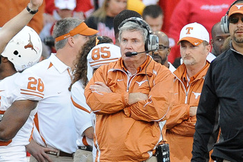 LINCOLN, NE - OCTOBER 16: Coach Mack Brown (center) of the Texas Longhorns watches as his team finishes off the Nebraska Cornuskers during second half action of their game at Memorial Stadium on October 16, 2010 in Lincoln, Nebraska. Texas Defeated Nebras