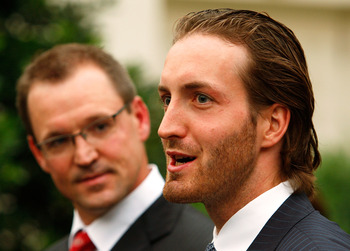 WASHINGTON - SEPTEMBER 10:  Pittsburgh Penguins head coach Dan Bylsma (L) and player Brooks Orpik (R) speak to the media after an East Room event September 10, 2009 at the White House in Washington, DC. U.S. President Barack Obama hosted the Penguins to h