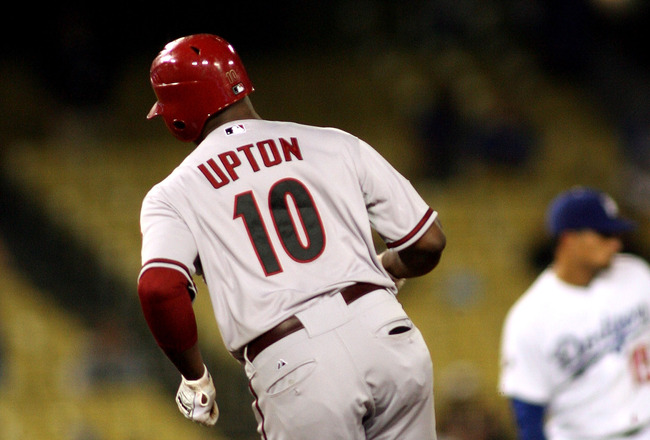 LOS ANGELES, CA - JULY 29:  Justin Upton #10 of the Arizona Diamondbacks rounds the bases after hitting a home run to center field against the Los Angeles Dodgers in the seventh inning of the game at Dodger Stadium on July 29, 2011 in Los Angeles, Califor