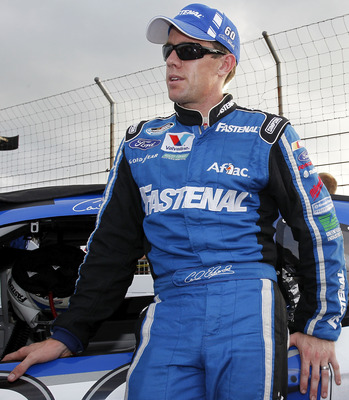 INDIANAPOLIS - JULY 30:  Carl Edwards, driver of the #60 Fastenal Ford, stands by his car on the grid prior to the start of  the NASCAR Nationwide Series Kroger 200 at Lucas Oil Raceway on July 30, 2011 in Indianapolis, Indiana.  (Photo by Geoff Burke/Get