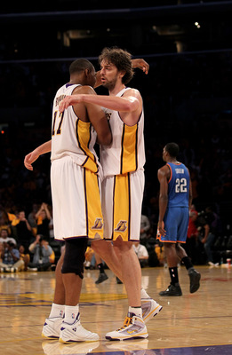 LOS ANGELES, CA - APRIL 18:  Pau Gasol #16 and Andrew Bynum #16 of the Los Angeles Lakers embrace after the game against the Oklahoma City Thunder during  Game One of the Western Conference Quarterfinals of the 2010 NBA Playoffs on April 18, 2010 at Stapl