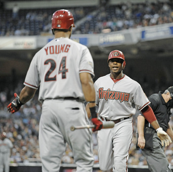SAN DIEGO, CA - JULY 27: Justin Upton #10 of the Arizona Diamondbacks is congratulated by teammate Chris Young #24 after Upton hit a solo home run during the fourth inning of a baseball game against the San Diego Padres at Petco Park on July 27, 2011 in S
