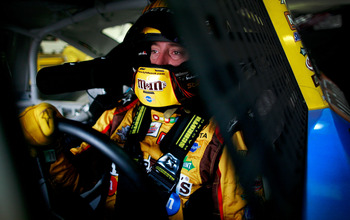 INDIANAPOLIS, IN - JULY 30:  Kyle Busch, driver of the #18 M&M's Toyota, sits in his car during practice for the NASCAR Sprint Cup Series Brickyard 400 at Indianapolis Motor Speedway on July 30, 2011 in Indianapolis, Indiana.  (Photo by Tom Pennington/Get