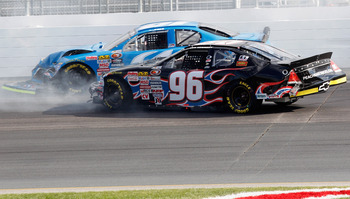 LOUDON, NH - JULY 15: Ben Kennedy, driver of the #96 Ben Kennedy Racing Chevrolet, crashes with Joey Polewarczyk, driver of the #61 Jack's Auto Service Chevrolet, during the NASCAR K&N Pro Series East New England 125 at New Hampshire Motor Speedway on Jul